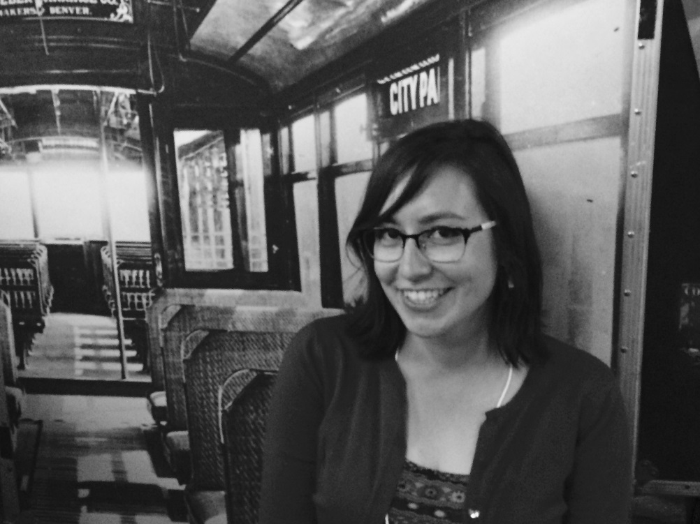 Mallory Furnier, Special Projects Archivist at the Autry National Center, looking happy in the old-fashioned Denver street car. Photo: Rachel Mandell